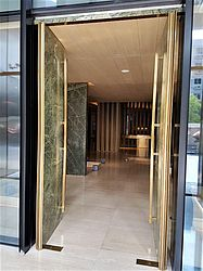 stone door with pivot hinges, hotel entrance door, Beijing, China