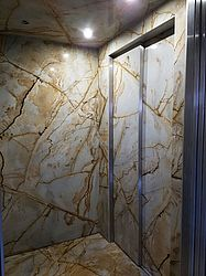 exclusive elevator cladding with thin stone for villa in Baden Baden