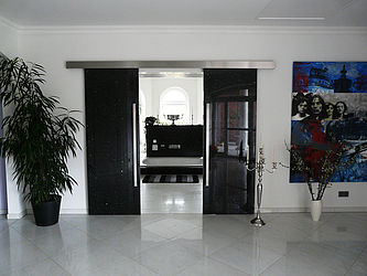 exclusive sliding door with natural stone Emerald Pearl