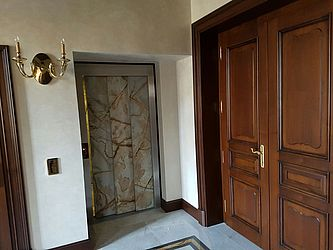 elevator cladding with thin stone for villa in Baden Baden